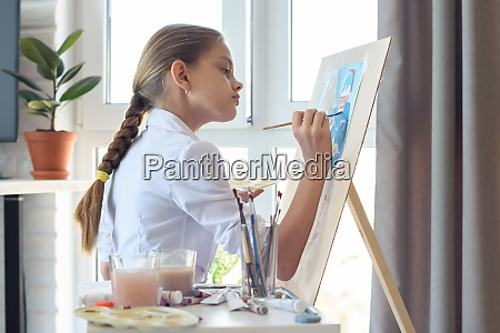 young artist draws watercolor in light