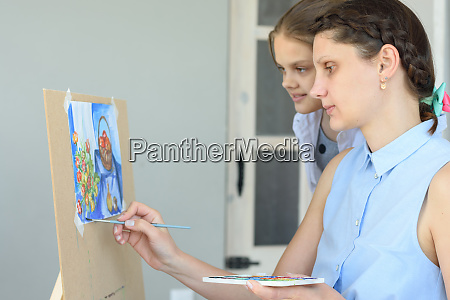 teacher teaches to paint the student
