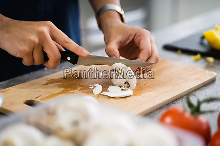 woman cooking dinner at home