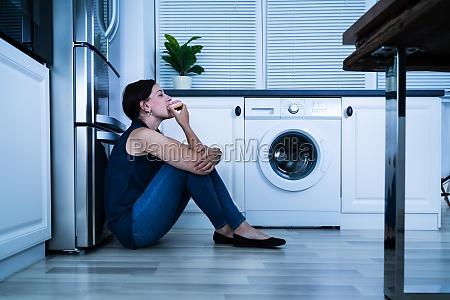 women eating at night near refrigerator