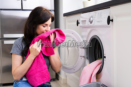 woman smelling clothes