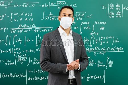 university professor standing in class