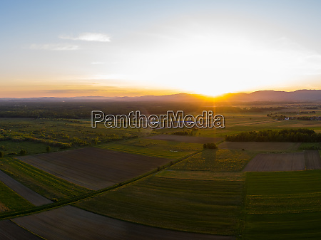 aerial view of sunset above plantations