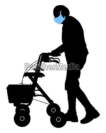 seniorin mit gesichtsmaske und rollator