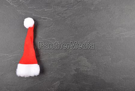 santa hat on slate background