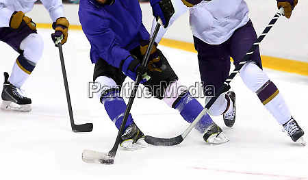 ice hockey player dribbling puck on