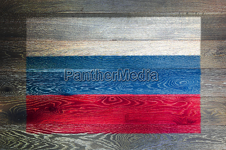 russian federation flag on wood texture