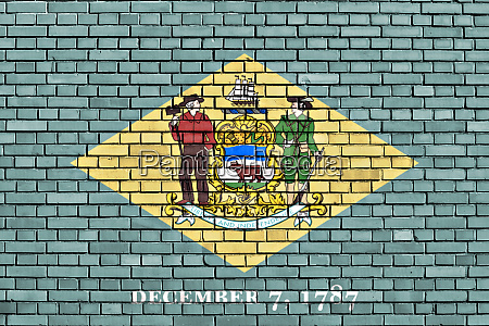 flag of delaware painted on brick