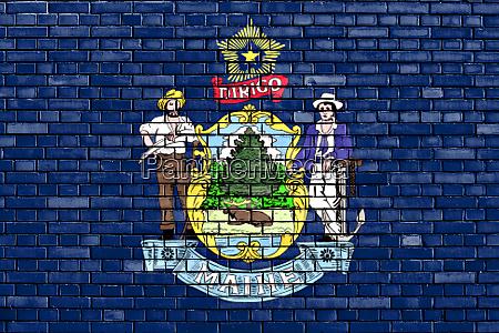flag of maine painted on brick