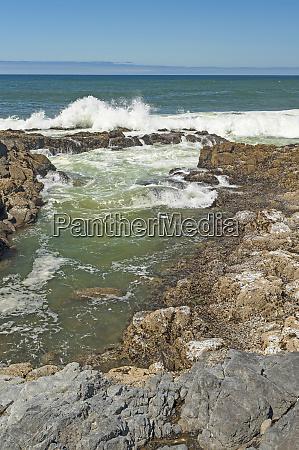 waves crashing over the coastal rocks