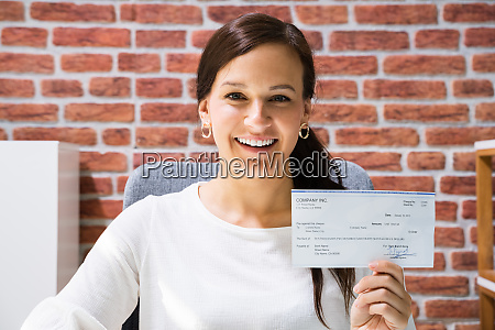 boss holding payroll bank check