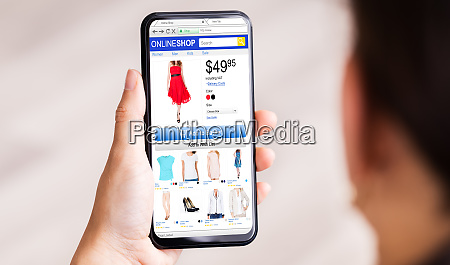 hand holding online ecommerce store open
