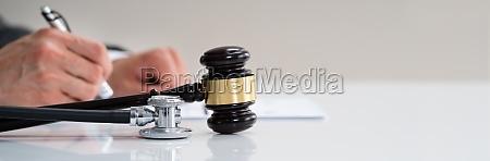 medical malpractice gavel and stethoscope