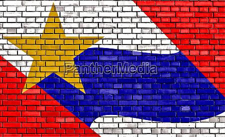 flag of lafayette painted on brick