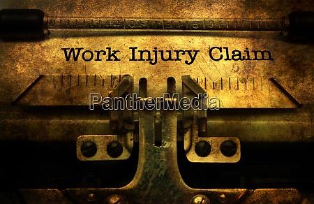work injury claim on typewriter