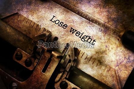 lose weight text on vintage typewriter
