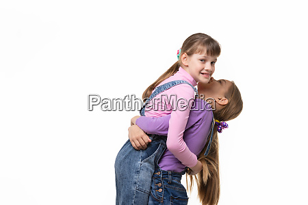 girl lifted and hugged another a