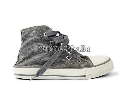black worn sneaker with textile untied