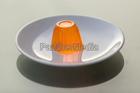 orange gelatin on a white plate