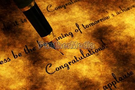 fountain pen on congratulation text