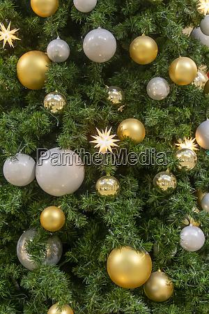 christmas ornaments on fir tree