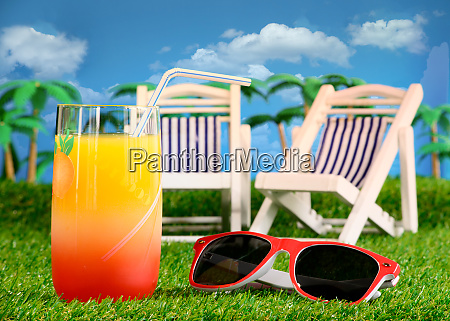 holiday concept orange juice lounge chairs