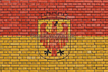 flag of potsdam painted on brick