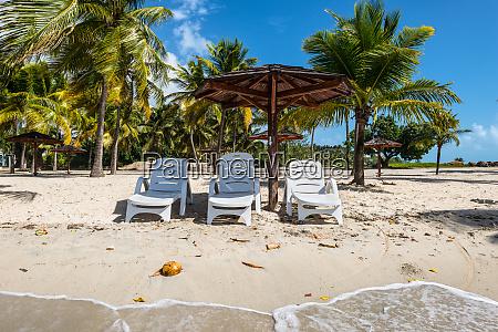 three chairs and umbrella on stunning