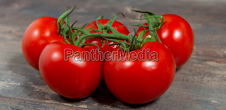 red cherry tomatoes on rustic background