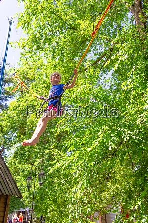 girl bungee jumping in trampoline