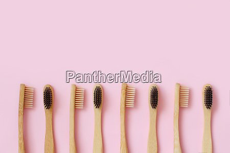 eco friendly bamboo toothbrushes on pink