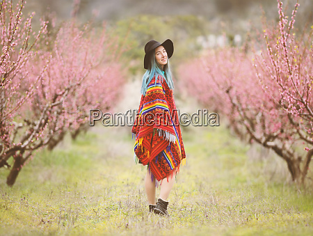 young woman in a blossom trees