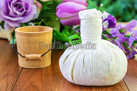 thai spa massage with herbal