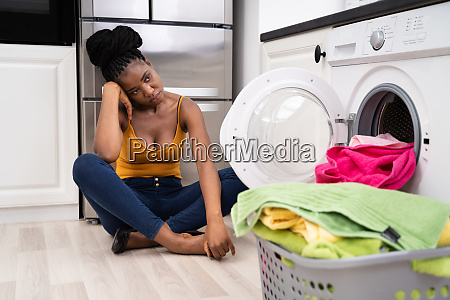 washing machine distressed sad frustrated woman