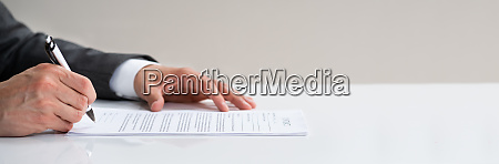 lawyer signing business contract legal document
