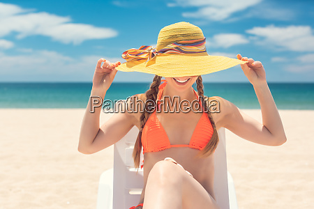 banner of woman tanning on the