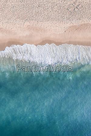 aerial view of ocean waves breaking