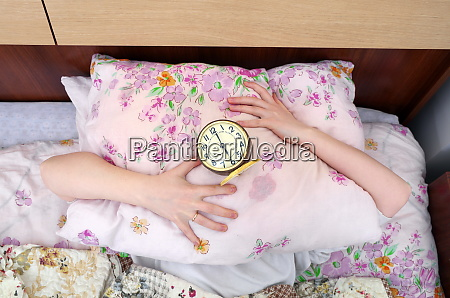 woman and alarm clock in the