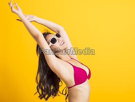 oung beautiful woman wearing swimsuit bikini