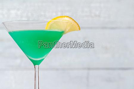 glass of green screwdriver