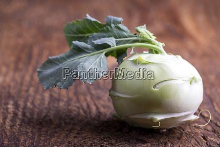 single raw cabbage turnip on wood