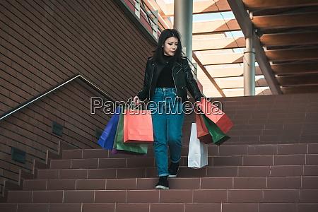 happy girl making shopping