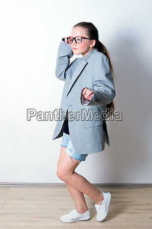 young funny girl with big suit