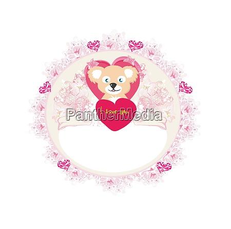 cute teddy bear with heart frame