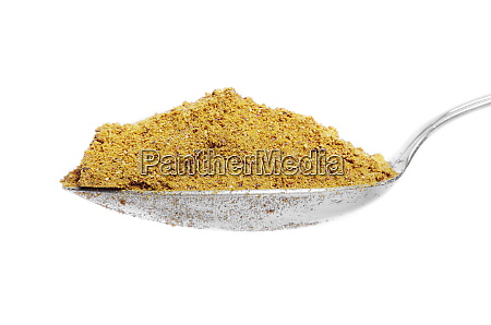 curry powder on metal spoon