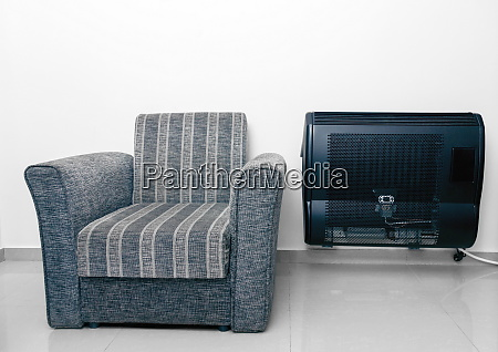 vintage soft armchair and heater in