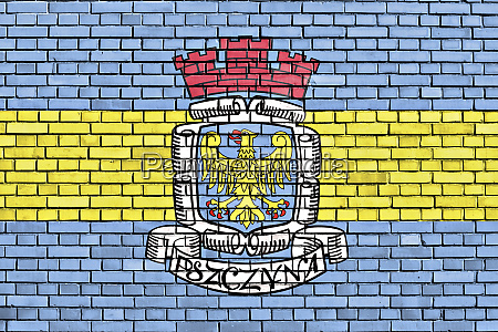 flag of pszczyna painted on brick