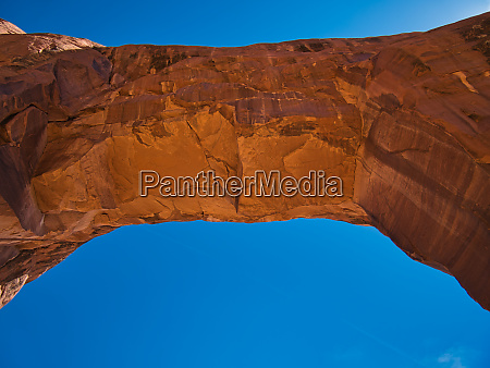 gigantic rock arch under the cloudless