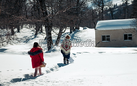 girl with mum walking in the
