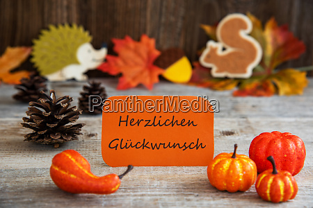 label with autumn decoration glueckwunsch means
